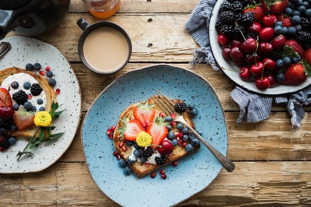 A blue plate full of fresh fruit