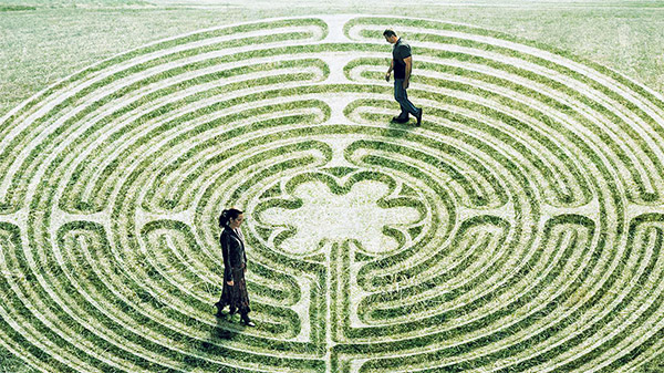 Two people walking around in a maze