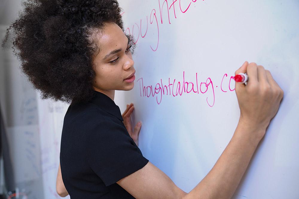 An educator at Pine Street Presbyterian Church writing on a whiteboard