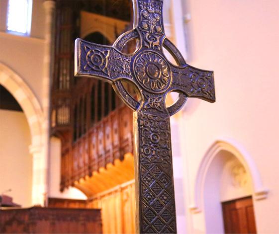 A religious cross standing in Pine Street Presbyterian Church